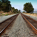 Railroad Tracks With The New Alfred Zampa Memorial Bridge And The Old Carquinez Bridge In Distance by Wingsdomain Art and Photography