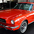 Red 1965 Ford Mustang . Front Angle by Wingsdomain Art and Photography