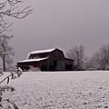 Red Barn Under Snow by Douglas Barnett
