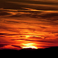 Red Clouds At Sunset by Rodney Cammauf