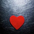 Red Felt Heart On Stainless Steel Background. by Ballyscanlon