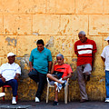Retired Men And Yellow Wall Cartegena by Thomas Marchessault