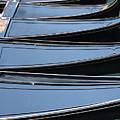 Row Of Gondolas In Venice by Michael Henderson