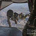 Sailors Jump Out Of A C2-a Greyhound by Stocktrek Images
