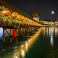 Scenic Night View Of The Chapel Bridge In Old Town Lucerne by George Oze