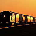 Setting Sun Reflecting Off Train And Track by Mark Duffy