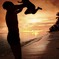 Silhouette Family Of Child Hold On Father Hand by Anek Suwannaphoom