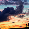 Silhouettes Of Three Girls Walking In The Sunset by Fabrizio Troiani