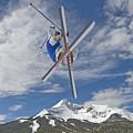 Skiing Aerial Maneuvers Off A Jump by Gordon Wiltsie