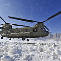 Snow Flies Up As A U.s. Army Ch-47 by Stocktrek Images