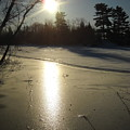 Sun Reflecting Off River Ice by Kent Lorentzen