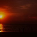 Sunset On Darwin Beach by Gary Wonning