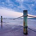 Sunset Reef Pilings by Adam Pender