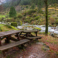 Tables By The River by Carlos Caetano