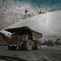 Trucks Hauling Waste Rock At Batu by Randy Olson