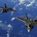 U.s. Air Force F-22 Raptors In Flight by Stocktrek Images