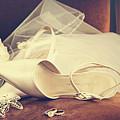 Wedding Shoes With Veil On Velvet Chair by Sandra Cunningham