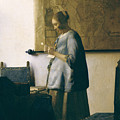 Woman Reading A Letter by Jan Vermeer