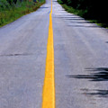 Yellow Dividing Line Marking An Empty Road Between Uxmal And Kabah by Sami Sarkis