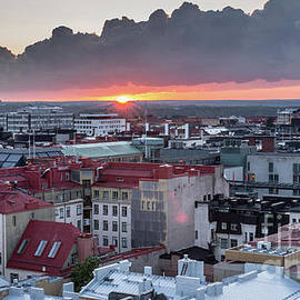 Yuval Helfman - Helsinki rooftops at Sunset with dark clouds