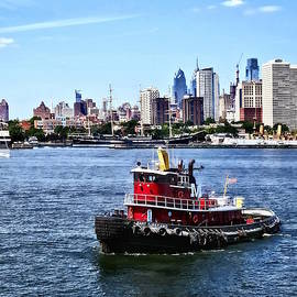 Susan Savad - Philadelphia PA - Tugboat by Philadelphia Skyline