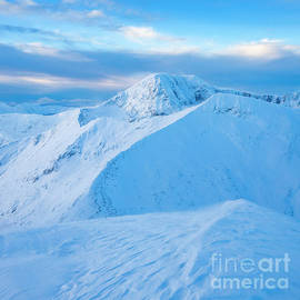 Winter view of Ben Nevis and Carn Mor Dearg from Aonach Mor, Scotland by Justin Foulkes