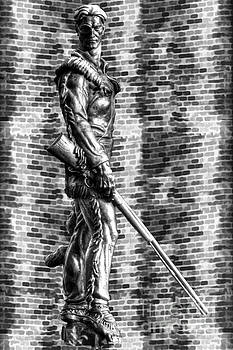 Dan Friend - Mountaineer statue bw brick background