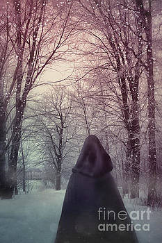 Sandra Cunningham - Mysterious Woman wearing cloak walking in snow