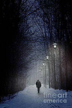 Sandra Cunningham - Old man walking on snowy winter path at night