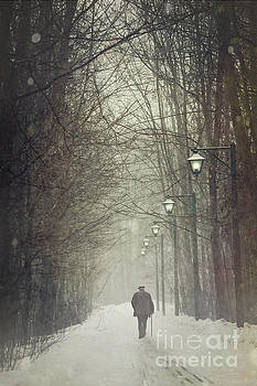 Sandra Cunningham - Old man walking on snowy winter path