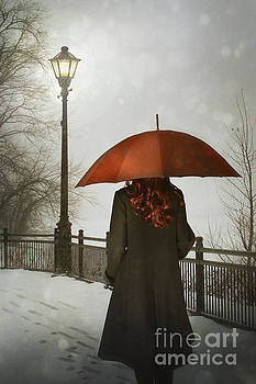 Sandra Cunningham - Woman with umbrella walking alone at night