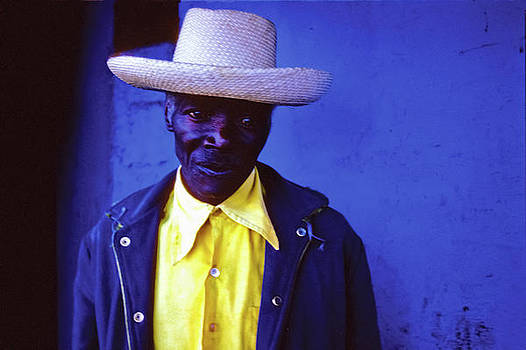 Johnny Sandaire - Blue Man with yellow hat and shirt