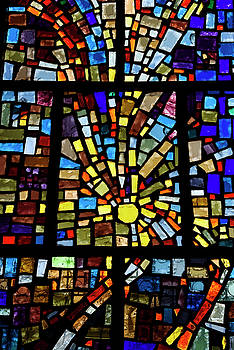 Reimar Gaertner - Abstract sun pattern of colors in a stained glass window mosaic