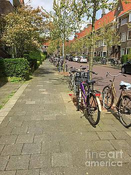 Patricia Hofmeester - Bikes in a street in Holland