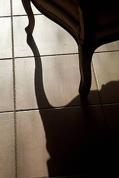 Sami Sarkis - Shadow of an armchair on a tiled floor