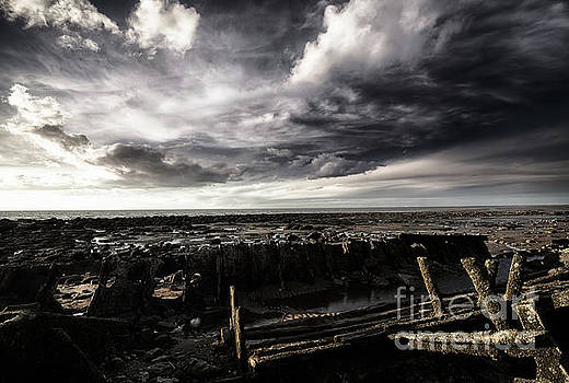 Simon Bratt Photography LRPS - Storm clouds over beached shipwreck