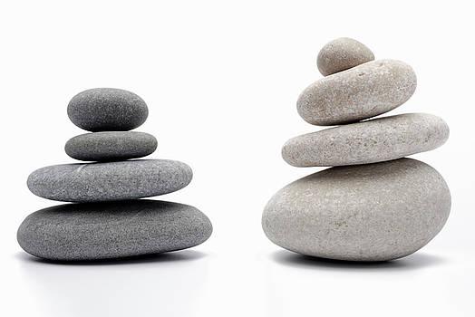 Sami Sarkis - Two stacks of white and gray pebbles