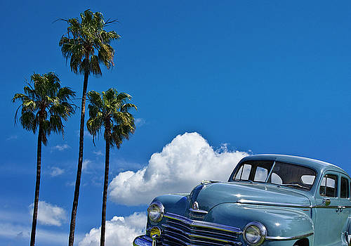 Randall Nyhof - Vintage Blue Plymouth Automobile against Palm Trees