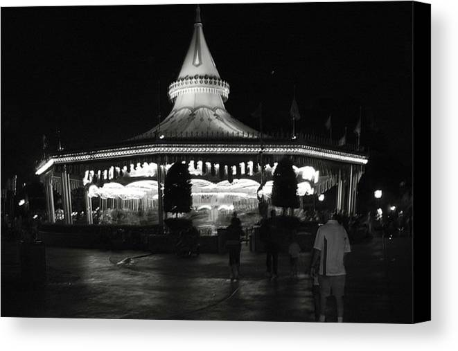 Black And White Canvas Print featuring the photograph Carousel by Lindsay Clark