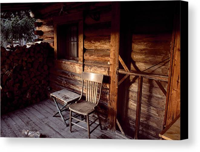 Outdoors Canvas Print featuring the photograph Firewood And A Chair On The Porch by Joel Sartore