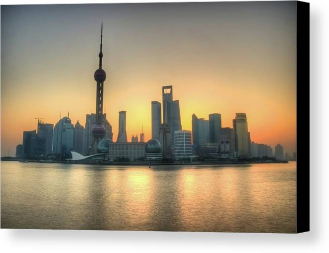 Horizontal Canvas Print featuring the photograph Skyline At Sunrise by Photo by Dan Goldberger