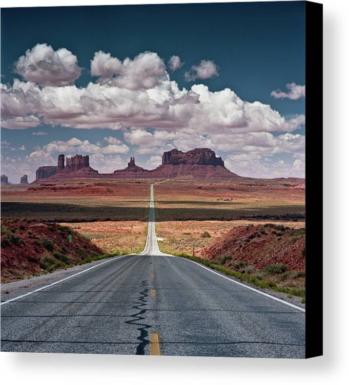 Vertical Canvas Print featuring the photograph Monument Valley by BrusselsImages