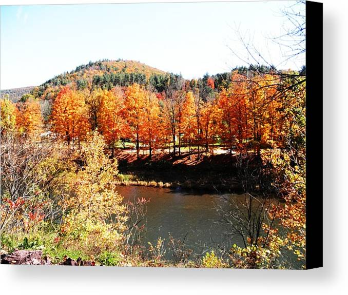Trees Canvas Print featuring the photograph Autumn By The River by Jeanette Oberholtzer
