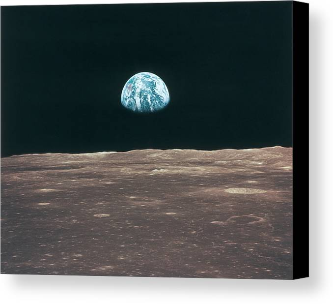 Horizontal Canvas Print featuring the photograph Planet Earth Viewed From The Moon by Stockbyte
