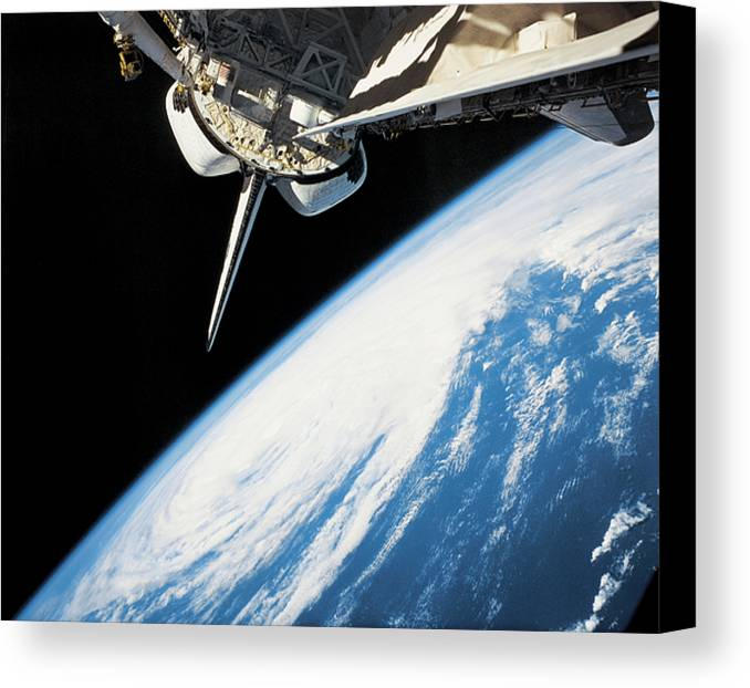 Horizontal Canvas Print featuring the photograph Space Shuttle In Outer Space by Stockbyte