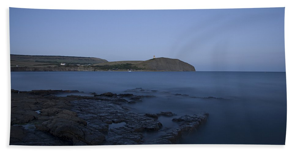 Kimmeridge Hand Towel featuring the photograph Kimmeridge Bay At Dusk In Dorset by Ian Middleton
