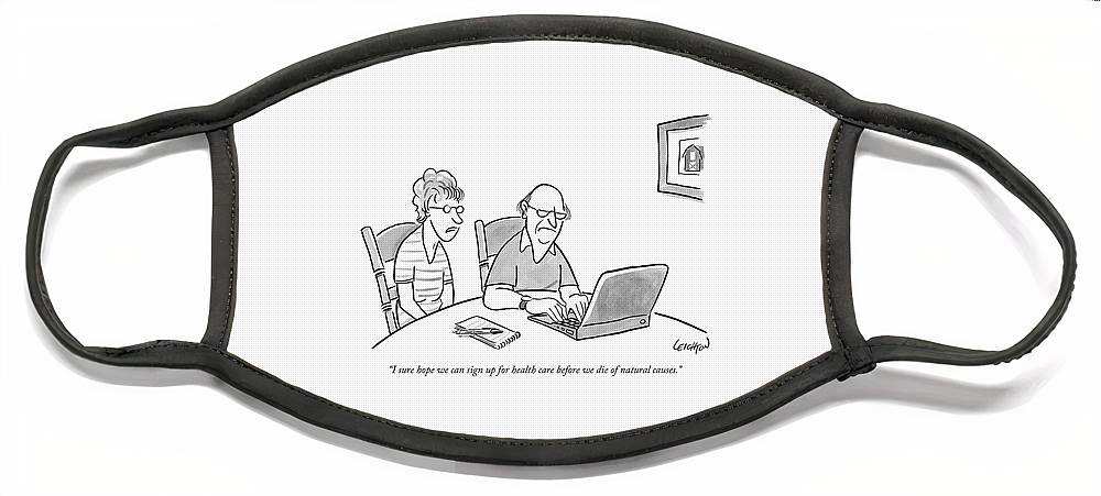 An Old Man And Old Woman Sit At A Laptop Face Mask
