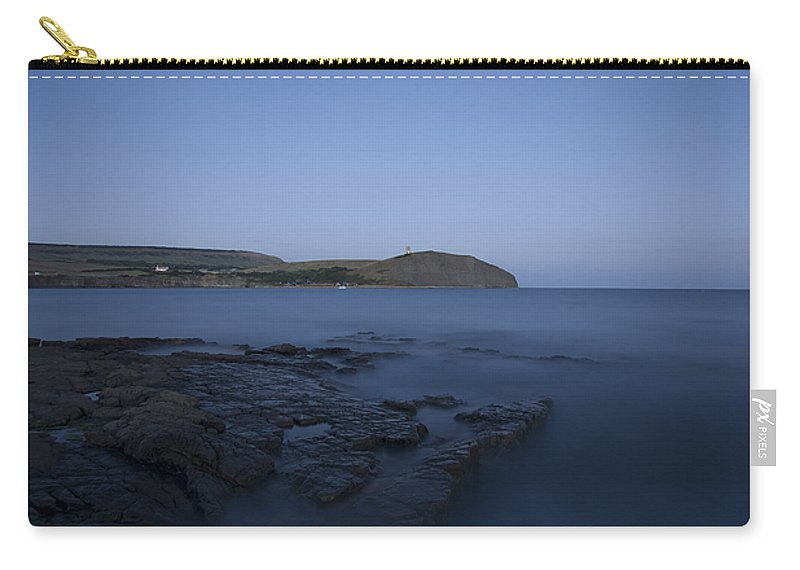 Kimmeridge Carry-all Pouch featuring the photograph Kimmeridge Bay At Dusk In Dorset by Ian Middleton