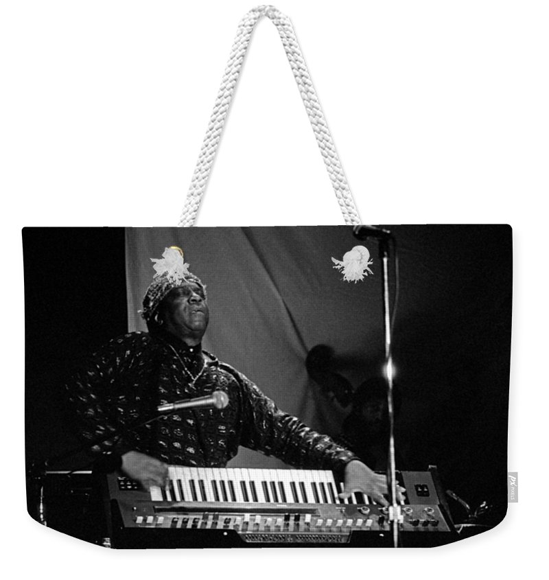 Sun Ra Weekender Tote Bag featuring the photograph Sun Ra 1 by Lee Santa