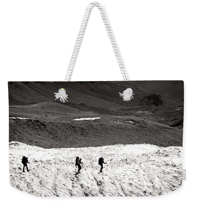 Active Weekender Tote Bag featuring the photograph They Are Going ... by Konstantin Dikovsky